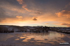 Frozen Pond Sunset (kevin-palmer) Tags: january winter wyoming nikond750 tamron2470mmf28 ice icy frozen pond lakedesmet reflection sunset dusk evening orange gold golden clouds sky color colorful hills cold
