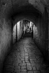 Dubrovnik, Croatia (pas le matin) Tags: croatia croatie dubrovnik city ville hrvatska silhouette night nuit street rue ruelle alley architecture cobblestone world travel voyage bw nb blackandwhite noiretblanc monochrome man homme canon 7d canon7d canoneos7d eos7d