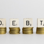 Debt text on coins thumbnail