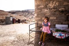 A little Yazidi girl on her bed in Mount Sinjar (Giulio Magnifico) Tags: syria sinjar 28mm iraq arabic da3sh kurdistan iraqi girl mount war yazidi kurdish genocide leicaq middleeast refugee civilwar isis leica child
