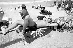 enjoying the sun at Manly beach, Sydney summer 2018-19  #867 (lynnb's snaps) Tags: afnikkor24mmf28d f80 ilfordhp5 manly nikon xtol bw beach film street 2018 nikonf80 kodakxtoldeveloper manlybeach sydney australia people coast man sunbaking sunbakers sunbathers towel siesta sand blackandwhite bianconegro biancoenero blackwhite bianconero blancoynegro noiretblanc schwarzweis monochrome ishootfilm filmneverdie sunny summer hot
