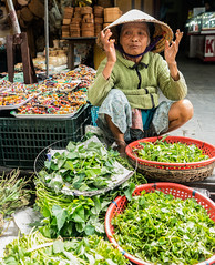 Exasperated (si_glogiewicz) Tags: vietnam asia south east communist viet market selling trading work shop vegetables produce fresh sale