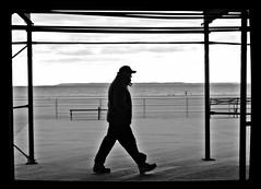 Passing Through (Robert S. Photography) Tags: boardwalk man walking beach winter brooklyn newyork brightonbeach coneyisland bw monochrome sony dsch55 iso125 january 2018