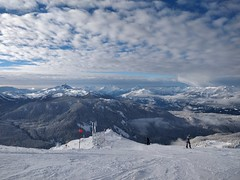 Black Tusk and distant rain shower from Peak to Creek (Ruth and Dave) Tags: whistler whistlermountain whistlerblackcomb peaktocreek coastmountains blacktusk snowboarder snowboarding skiresort slope piste run trail blue clouds weather weatherphotography shower rain range panorama