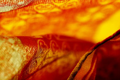 cloth (1crzqbn) Tags: macromondays cloth macro bokeh shadows yellow dof textures red orange