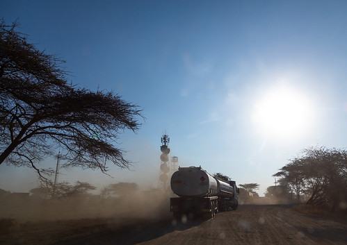 Trucks coming from djibouti port on a dusty road, Oromia, Awash, Ethiopia