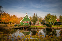 Zaanse Schans (AMSDekker) Tags: thenetherlands zaanseschans colouredhouses water reflection holland autumn trees tourism zaandam canon sky clouds supershots