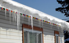 Icicles in December (yooperann) Tags: white house red trim icicles sunny day christmas holiday colored lights ki sawyer gwinn upper peninsula michigan