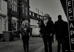 Escape (Bury Gardener) Tags: burystedmunds bw blackandwhite britain suffolk street streetphotography snaps streetcandids strangers candid candids people peoplewatching folks 2018 stjohnsstreet