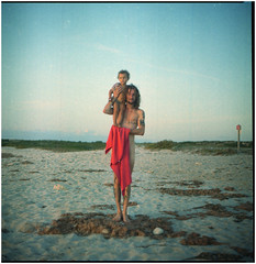 .ripe and whole we can move outside us (Herr Benini) Tags: sardegna sardinia kiev88 analog 6x6 120 mediumformat oristano men child redtowel beach