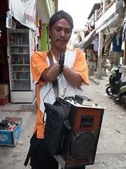 Man With No Hands in Muara Baru, jakarta (deemixx) Tags: disabled amputee handicapped streetperformer streetmusician muarabaru jakarta indonesia