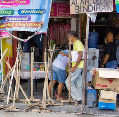 Clutter (Beegee49) Tags: street cluttered sidewalk wooden tools man walking happy planet sony a6000 silay city philippines asia
