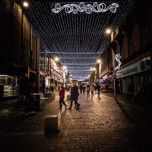 Paisley High Street as the crowds disperse with the Christmas lights above the street. #paisley #christmaslights taken by David Cameron.