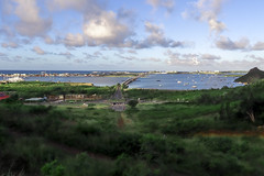Colebay Causeway View (dean.duporte) Tags: green hill boat veiw clouds water landscape sea sky trails island morning shadows shade