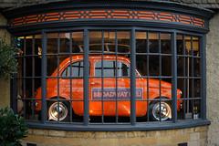 The Broadway Deli (judy dean) Tags: judydean 2019 lensbaby broadway delicatessan deli window foodstore car orange