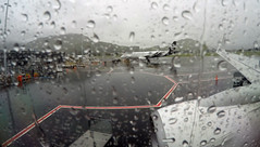 Wet departure (OzzRod (on the wallaby)) Tags: goprohero4silver rain raindrops plane window tarmac queenstown newzealand travel airport