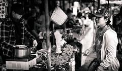 Street Food Heaven (dlerps) Tags: bkk bangkok city daniellerps lerps sony sonyalpha sonyalpha99ii tha thai thailand urban lerpsphotography metropolitan monochrome blackwhite bw streetfood pot food woman market chatuchak chatuchakmarket weekendmarket paying foodstall carlzeiss carlzeissplanar50mmf14ssm planart1450 seafood