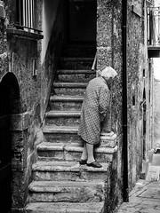 Peek (mr.reverend) Tags: ambush elderly woman country village ancient history stairs street streetphoto streetphotography streetlife candid urban urbanlife city citylife scanno abruzzo italy blackandwhite monochrome