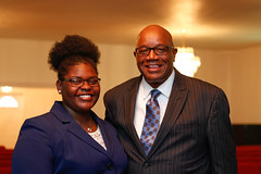 A'Nasia Monford poses for a portrait with pastor, Herman Laguins, after a service at the church.