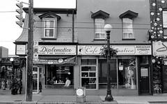 Cafe Diplimatico (Bill Smith1) Tags: believeinfilm billsmithsphotography hc110b heyfsc kodaktrix400 nikkorai50f2lens nikonfm toronto