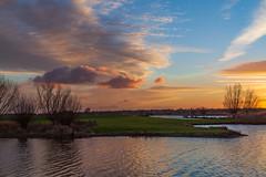 Sunset in the polder (jan.vd.wolf) Tags: sunset zonsondergang polder river water sky cloud wolken tree lake meer