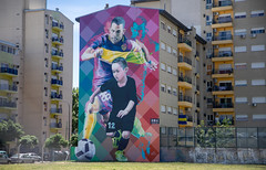 A mural of Boca Juniors star Carlos Tevez and a young boy playing soccer in La Boca neighborhood of Buenos Aires. (apardavila) Tags: argentina bocajuniors buenosaires carlostevez laboca southamerica art artwork futbol mural soccer streetart travel wanderlust