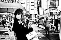 Rainy consumerism.... (Victor Borst) Tags: street streetphotography streetlife reallife real realpeople asia asian asians faces face candid travel travelling trip traveling urban urbanroots urbanjungle blackandwhite bw mono mo monotone monochrome city cityscape citylife japan japanese lady woman girl female raw rain rainy raining umbrella umbrellas tokyo shibuyacrossing fuji fujifilm xpro2