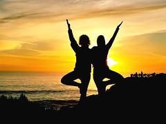 Yoga Friendship (moonjazz) Tags: yoga friends dance sun sunset women beauty peace zen hands connection balance female sky color photography pose celebration life ocean amigos california alive health wisdom free energy blessings prayer thankfulness