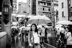 Osaka - Dotonbori (-dow-) Tags: 大阪 日本 osaka giappone japan rain pioggia umbrella ombrelli monochrome fujifilm x70