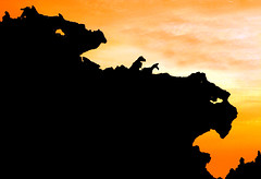 Sunset in Jurassic Land! (Vafa Nematzadeh Photography) Tags: hormuz island persiangulf hormozgan iran hormoz sunset valley statues dragon dinosaur smilodon tyrannosaurustrex jurassic jurassicland lostworld dreamscape discovery statue silhouette light darkness rocks earth sky travel vafaphotography natgeo nationalgeographic dramaticsky dusk twilight moodysky backlit natgeotravel landscape