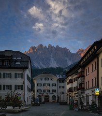 San Candido, Val Pusteria, Italy (ludwigriml) Tags: altoaldige cliffs clouds dolomites evening innichen italy ludwigrimlphotography market marketplace mountainrange naturallightphotography piks pustertal sancandido southtyrol sunset town valpusteria alps city houses mountains outdoors street