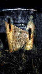 LUCY: wife of thomas day until 1852, a long life lived; a strong wife loved; a few words told her tale etched in stone; the rest they left to fade with flesh, whats left is stone and dirt pressing against and meshing with remnants of bone. (reallanthreee) Tags: rip headstone cemetery grave 1800s