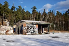 remains (twurdemann) Tags: abandoned agawabay algomadistrict art boxingday canada destruction firedamage fujixt1 garage gasstation graffiti highway17 lakesuperiorprovincialpark northernontario ontario ontarioparks servicestation streetart toad vandalism viveza winter xf1855mm