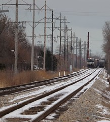 Down the line (DonnieMarcos) Tags: m337 railroad railway railfanning cn canadiannational freeport freeportsub cnfreeportsub berwyn berwynil rail railfan rails cnr ns norfolksouthern snow winter telephoto depth