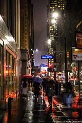 (kayters) Tags: rain raining wet umbrella winter february newyorkcity newyork eastcoast kaytedolmatchphotography kathleendolmatch explore travel adventure nightphotography canon cityscape portrait citylights midtown colorful colors streetphotography