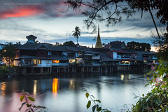 Chanthaburi Old Town (Chanthaburi Riverside Community) along the river bank after sunset. (baddoguy) Tags: cityscape color image community dramatic sky dusk famous place frame horizontal house human settlement idyllic igniting in a row landscape local landmark nature no people nonurban scene old town outdoors pagoda photography river riverbank social history southeast asia temple building thai culture thailand the past tourism tranquility travel destinations tree twilight urban skyline village waterfront