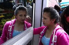 Girl entering a shop, Cuenca (klauslang99) Tags: klauslang streetphotography people person reflection cuenca ecuador mirror