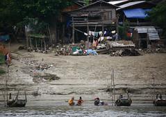 Irrawaddy River Banks Daily Life, Myanmar (Eric Lafforgue) Tags: asia myanmar burma tourism traditionallymyanmarian innwa boat ruralscene outdoors horizontal colourpicture traveldestinations smallgroupofpeople burma7211