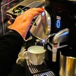 Person using a Nespresso machine thumbnail
