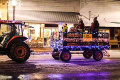 Wagon (wyojones) Tags: wyoming cody christmasparade sheridanavenue snow cold tractor man driver wagon children woman lights christmas wyojones