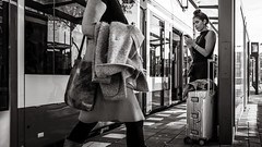 distracted (Gerard Koopen) Tags: nederland netherlands amsterdam capital city reflections traveling tram publictransport gvb distracted straat street straatfotografie streetphotography streetlife bw blackandwhite blackandwhiteonly fujifilm fuji x100t fujilove fujilover beautiful woman women luggage 2018 gerard koopen gerardkoopenphotography inexplore