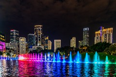Colorful fountain in front of Kuala Lumpur Skyline. (Sander Pot) Tags: neon water klccpark klcc longexposure blue red park capital petronas twintowers cityscape city tamron nikond850 d850 nikon nightphotography night dark architecture skyscrapers skyline skyscraper lightshow show fountain colorful colors color malaysia kualalumpur