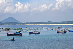 fishing day (bluefam) Tags: fishing sea boat beach net sky cloud