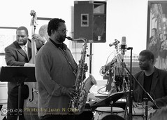 Planet D Nonet at the Scarab Club [50D-1545GS-Crop] (Juan N Only Music Photos) Tags: planetdnonet planetd pd9 scarabclub detroit michigan jazz ensemble bigband rjspangler jamesodonnell music artgallery gallery livemusic saxophone saxphonist bass acousticbass bassist conga april 2010 juannonly blackandwhite blackwhite concert musicians