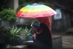 The Rainbow Queen (N A Y E E M) Tags: woman burqa umbrella rain colors afternoon street ashkardighirpar chittagong bangladesh windshield