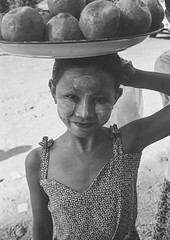 Burmese Girl Selling Coconuts, Ngapali, Myanmar (Eric Lafforgue) Tags: 67years asia asian beautifulpeople blackandwhite burma carrying cheek child childwork childrenonly day decoration exoticism face facepowder grainy innocence lookingatcamera makeup myanmar ngapali onegirlonly oneperson outdoors paintedface pattern photography portrait suncream thanaka tourism traditionalculture traveldestinations trix vertical waistup leicaburma293 rakhinestate