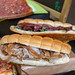 Italian sandwiches with porcetta, soft cheese, dtied tomatos and rocket salad