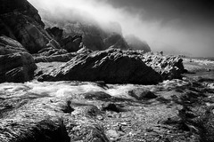 Combe Martin Noir (Christian Hacker) Tags: combemartin seafog haar mysterious stream water river blackandwhite bw mono monochrome rocks cliffs dramatic northdevon landscape canon eos50d tamron 1750mm rocky rugged seaweed coast coastal coastline beach pebbles