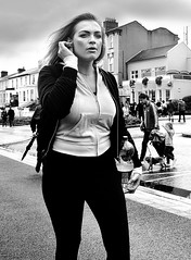 Along the Strand (Owen J Fitzpatrick) Tags: ojf people photography nikon fitzpatrick owen pretty pavement chasing d3100 ireland editorial use only ojfitzpatrick eire dublin republic city tamron candid joe candidphotography candidphoto unposed natural attractive beauty beautiful woman female lady j along photoshoot street 2018 dslr digital streetphoto streetphotography black white mono blackwhite blackandwhite monochrome blancoynegro pretoebranco bw bray town air show hair blonde face visage prom pink top eye contact strand road wicklow co county irish