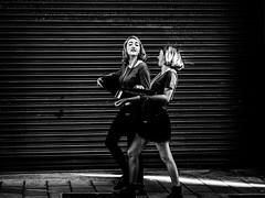 from project shutters pic 5 by feej13 x (FeeJane) Tags: brighton street streetphotography shutters feej13 blackandwhite highcontrast laughing girls portrait people